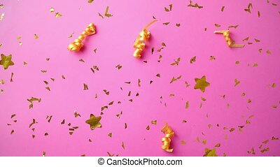 Pink party background with golden confetti and serpentines....