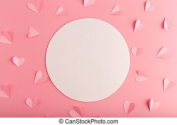 pink pastel background with white circle and hearts