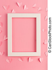 pink pastel background with white frame and hearts