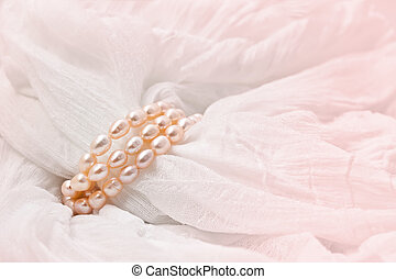 Pink pearls on a Pink background. Wedding backgrounds.
