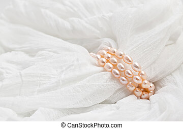Pink pearls on a white background. Wedding backgrounds.