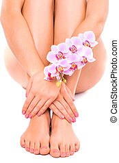 pink pedicure and manicure with orchid flower