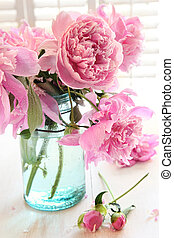 Pink peonies in glass jar