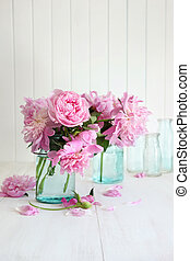 Pink peonies in glass jars