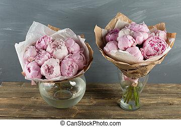 Pink peonies in vase. retro styled photo.