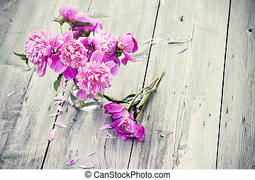 Pink peonies on wooden background - vintage photo