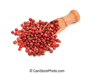 Pink pepper, Red peppercorns in a wooden spoon