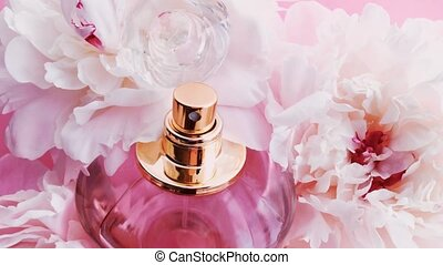 Pink perfume bottle with peony flowers, chic fragrance scent as luxury cosmetic, fashion and beauty product backgrounds