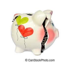 Pink piggy bank broken with money