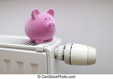 Pink piggy bank on radiator