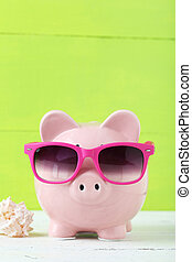 Pink piggy bank on white wooden background