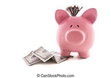 Pink piggy bank standing on dollars with dollar note stuck...