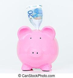 Pink piggy bank with bill