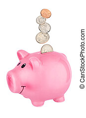 Pink piggy bank with falling coins isolated on white
