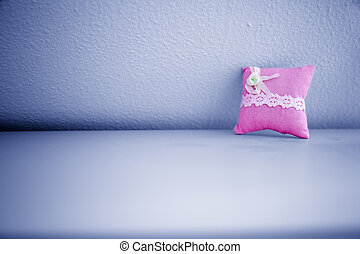 Pink Pillow on Wall