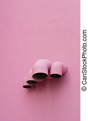 Pink pipes on wall