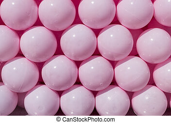 pink plastic balls. background, texture.