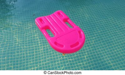 rescue buoy in the pool - pink plastic rescue buoy in the...