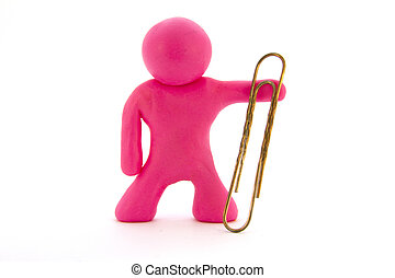 Pink plasticine character and big paperclip. Stationery. Isolated over white background