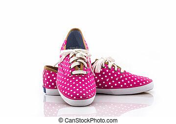 Pink polka dot canvas shoe. - Pink polka dot canvas shoe on...