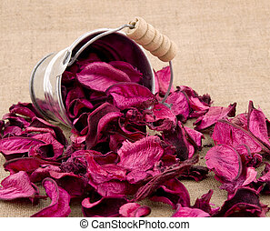 Pink potpourri in small bucket on linen background