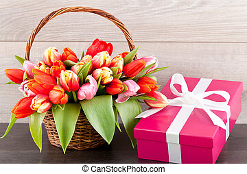 pink present with ribbon and colorful tulips festive easter decoration