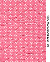 Close up of pink quilt.