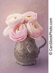 Pink ranunculus flowers on a lilac background