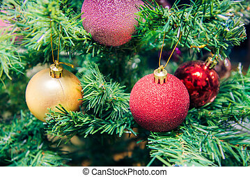 pink, red and golden balls on Christmas tree