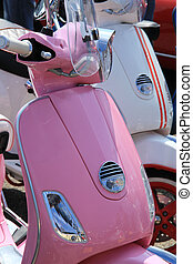 Pink retro scooter - Shinny pink retro scooter in a group