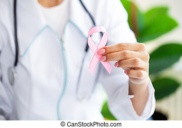 Pink ribbon for breast cancer awareness in doctor
