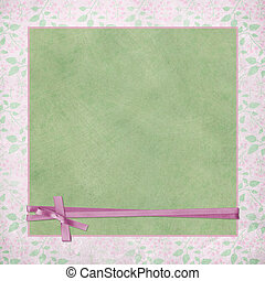 pink ribbon on green background