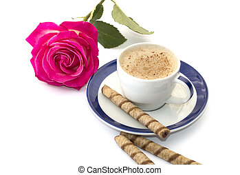 pink rose and cappuccino on a saucer with blue