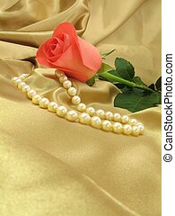 Pink rose and pearls on gold satin
