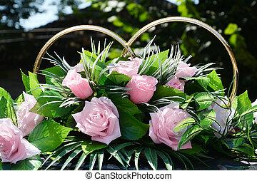 Pink rose and wedding ring