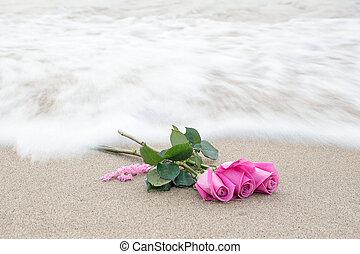 pink rose bouquet on beach