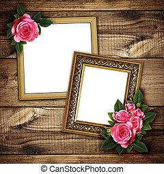 Pink rose flowers arrangement on frames on wood