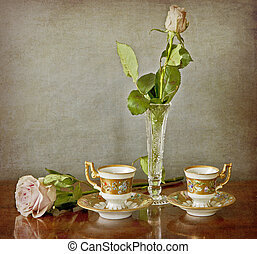 Pink rose in a crystal vase and espresso for two