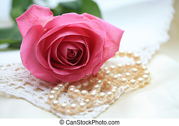 pink rose on pearls and lace