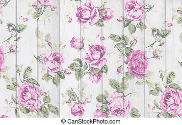 pink rose vintage from fabric on white wooden background