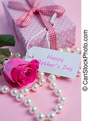 Pink rose with gift and string of p