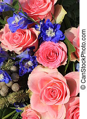 Pink roses and blue larkspur