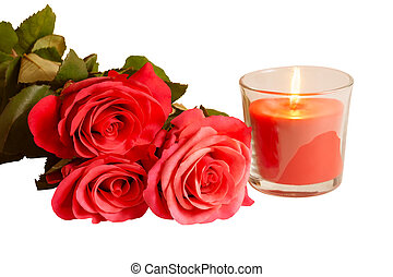 Pink roses and candle isolated