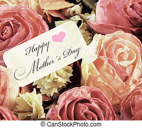 Pink roses and card with text mothers day