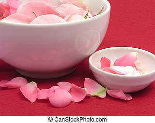 Pink roses and cream in white bowls of chinaware on red background