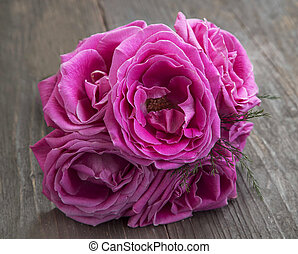 Pink roses bouquet on wooden background