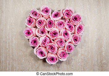 Pink roses Heart shape on wood