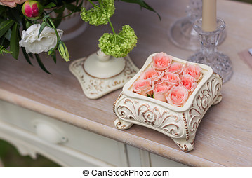 Pink roses in a ceramic box on the table-2