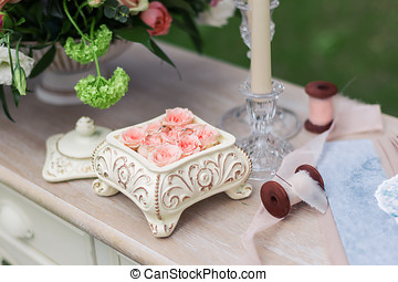 Pink roses in a ceramic box on the table