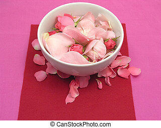 Pink roses in a white bowl of chinaware on red background